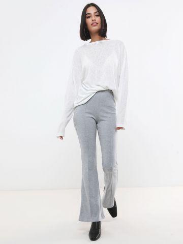 מכנסיים מתרחבים עם תפר דקורטיבי