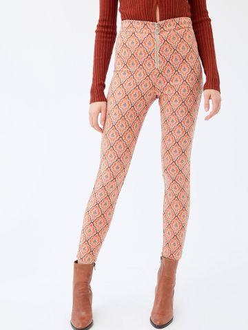 מכנסי ג'קארד בדוגמת מעויינים עם רוכסן UO