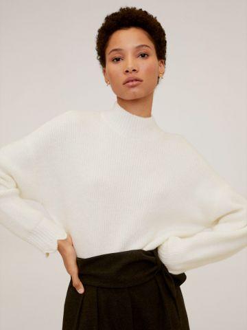 סוודר ריב עם שוליים גליים