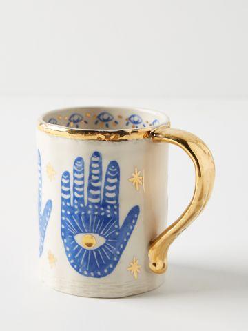 מאג חרס בדוגמת חמסה עם עיטורי זהב