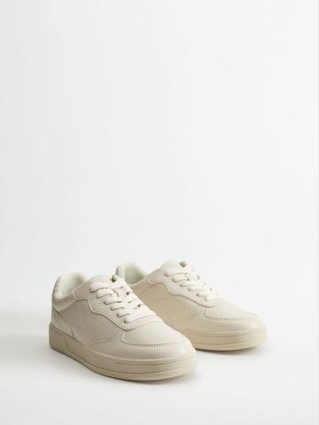 נעלי סניקרס דמוי עור / נשים