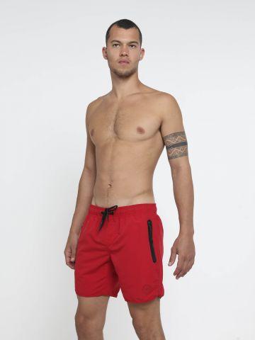 מכנסי בגד ים עם כיסים מודגשים