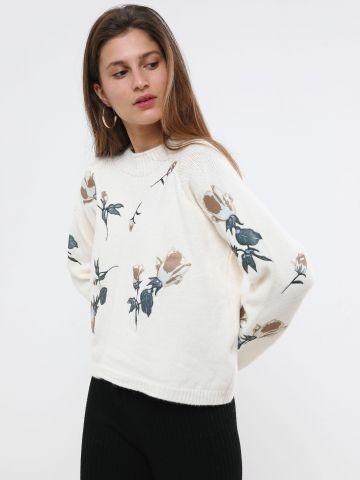 סוודר עם רקמת פרחים