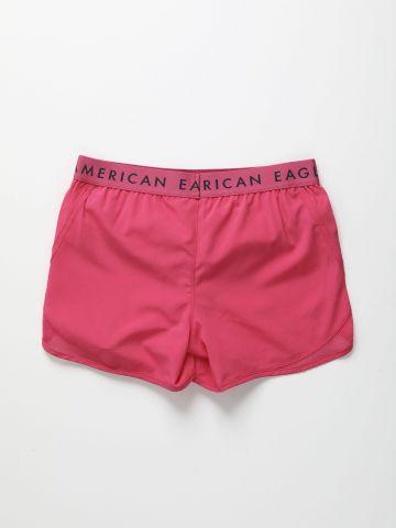 מכנסי אקטיב קצרים עם גומי לוגו / בנות
