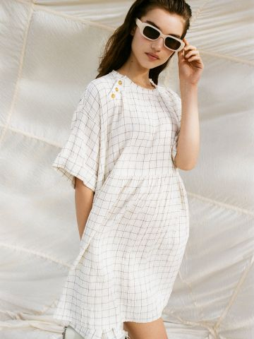שמלת מיני אוברסייז בהדפס משבצות UO