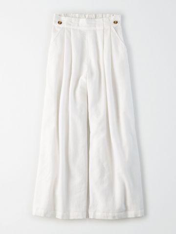 מכנסיים רחבים עם כפתורים / נשים