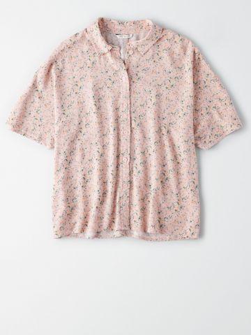 חולצה מכופתרת בהדפס פרחים / נשים