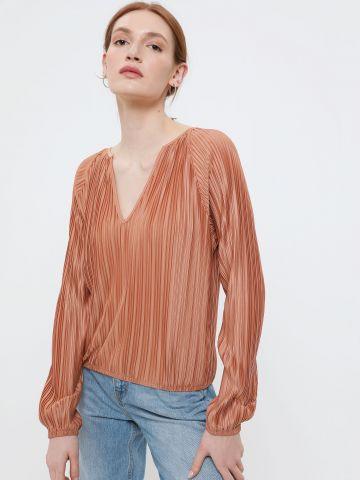 חולצת פליסה בגימור מבריק