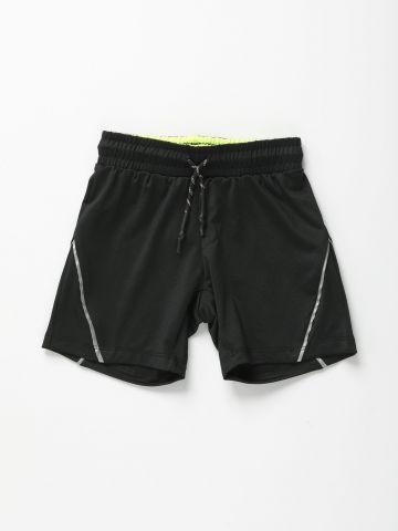 מכנסי ספורט עם סטריפים מחזירי אור / בנים