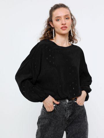 חולצת קרופ בדוגמת נקודות מבריקות
