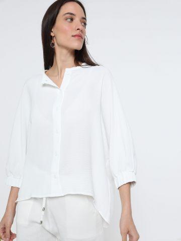 חולצה מכופתרת עם סיומת אסימטרית