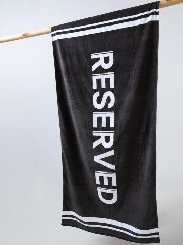 מגבת חוף עם הדפס RESERVED