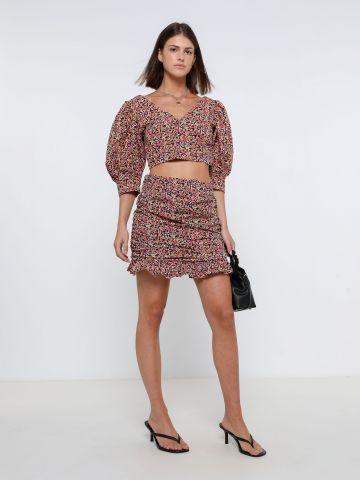 חצאית מיני עם עיטורי קפלים של YANGA